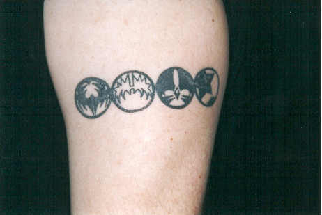 icon tribal band left upper arm. Illustrator Tattoo, Dallas, GA 1998